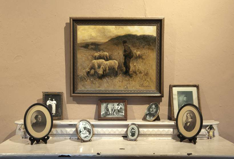 Mantel in the office shows one of Couse's paintings and photographs of the generations of the Couse family.