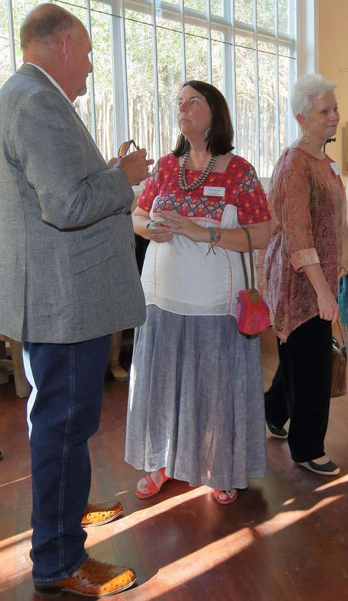 Board Chairman and Vice President Rich Rinehart with Board Member Laura Finlay Smith as Susan Fisher, executive director at the Taos Art Museum - Fechin House, to the right